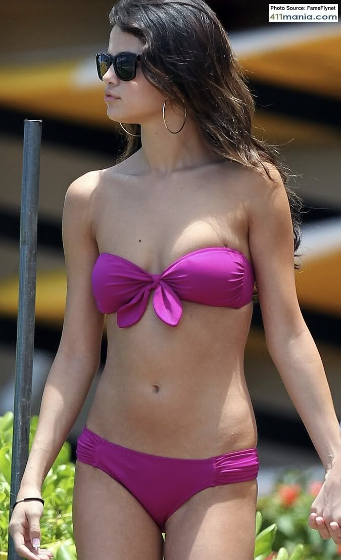 SELENA GOMEZ in purple | 411mania.com: Music - Selena Gomez Looking Sexy In Purple Bikini