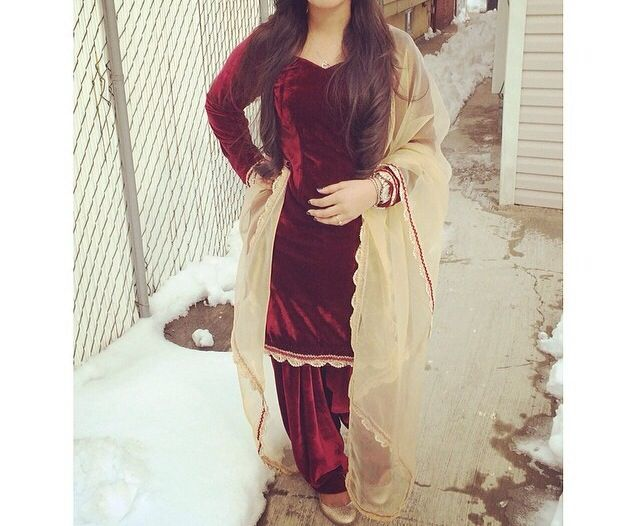Red velvet salwar suit  with a beige net chunni. Sophisticated yet traditional