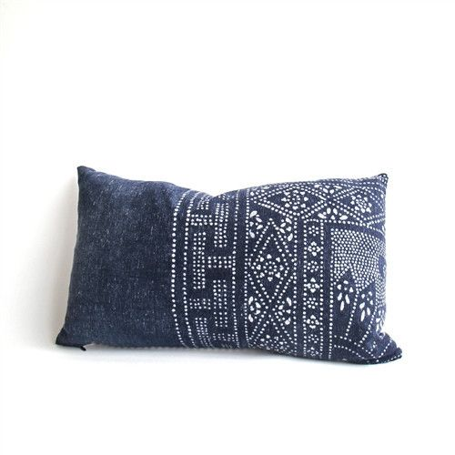 This pillow is made with handwoven vintage indigo cotton batik from the Hmong hill tribes of Southeast Asia. Adding a bit of Americana to these Asian panels, they have been backed with cotton ticking.