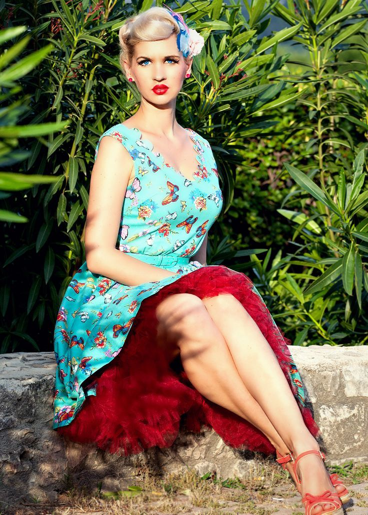 The Dorothy Dress This beautiful vibrant butterfly print creates an interesting twist to the classic 50's silhouette Dress features include good quality medium weight stretch cotton fabric. Wide flared skirt, attractive scalloped neckline. Slight V shape to the back of dress. Matching removable belt. Fully lined. Hidden side zip.