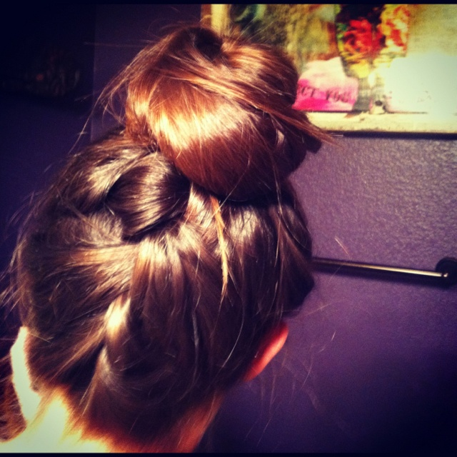 Backwards French braid into a messy bun. Takes some coordination but it's surprisingly easy.
