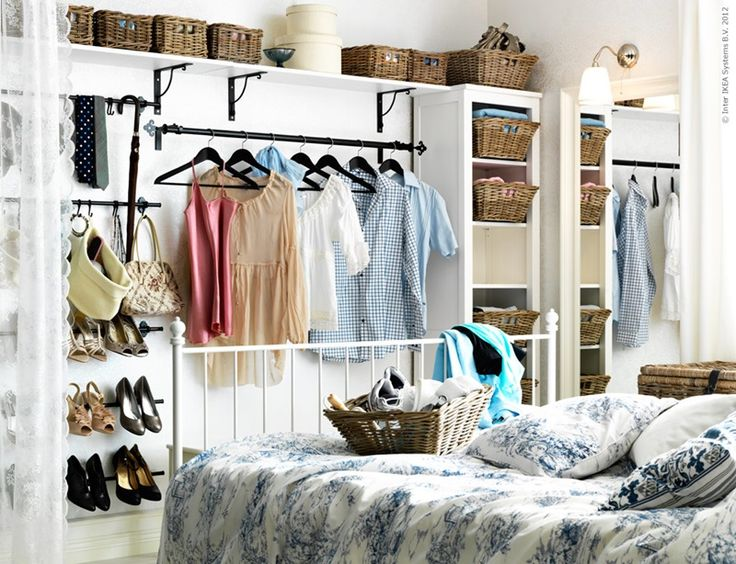A small-bedroom-storage-solution. Maybe add Sheer curtains, ringed onto long poles, to 'cover' the closet.