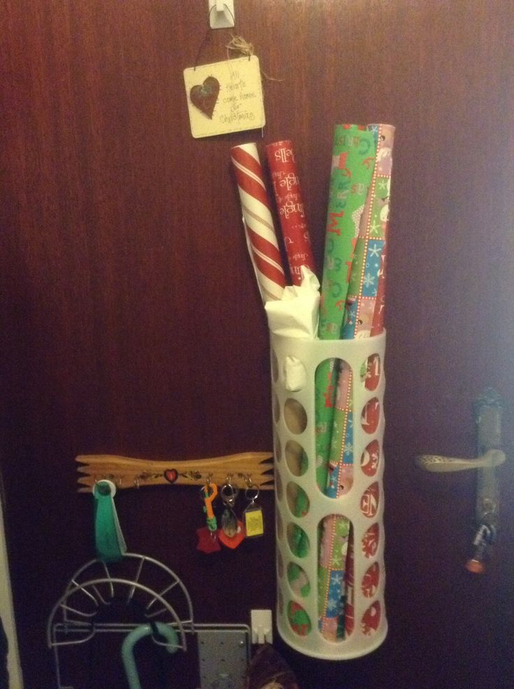I found this solution for storing wrapping paper on Pinterest  Its an Ikea item and I have attached it to my laundy door