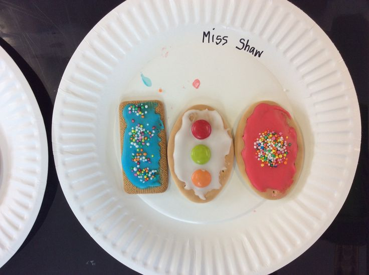 Ice and decorate biscuits for 100 days of school. We used Arnott's malt-o-milks and milk arrowroots.
