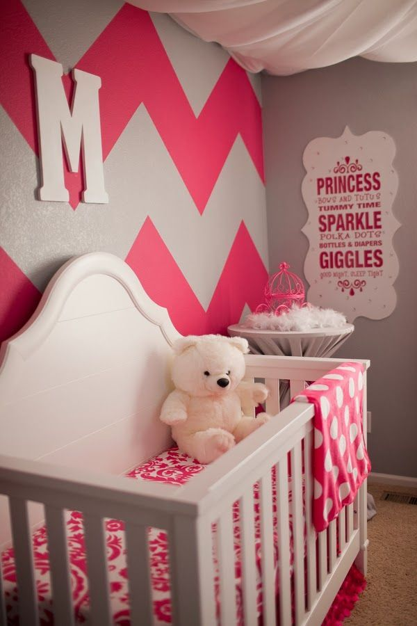 The Frosted Petticoat: Pop of Pink - A monogramed chevron wall frames the little one's crib and all the pops of pink bring the nursery full circle. #babygirlnursery
