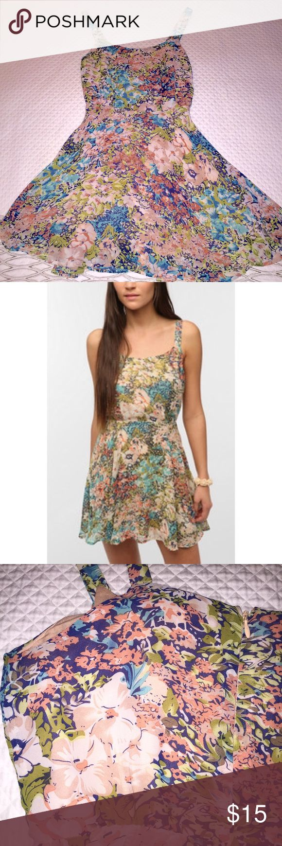 "Lucca Couture/Urban Outfitters floral dress Flirty and fun floral dress by Urban Outfitters Lucca Couture line. 100% polyester, fully lined, beautiful design. Zipper and clasp closure. Waist 28"", bust 35.5"", overall length 33"". Size S Urban Outfitters Dresses Mini"