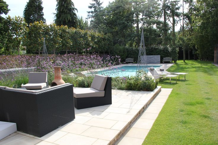 Our Buff Sandstone is also perfect for complementing a swimming pool, as shown in this garden designed by Amanda Broughton Garden Designs and built by Moyglen Construction.
