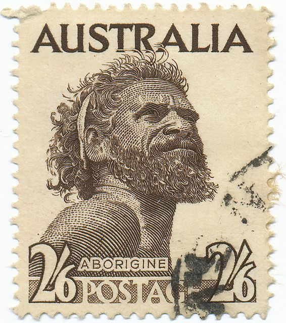 "One Pound Jimmy stamp. Gwoya Jungarai, born in 1895, apparently gained his nickname from his catchphrase. Whenever a white man asked how much he wanted for one of his boomerangs, he would reputedly reply, ""One pound, boss"". In 1950 this photograph by Roy Dunstan was used to make philatelic history. Australia Post issued two stamps - 8 pence and half a crown - called ""Aborigine"". For the first time an actual portrait of an indigenous person had been used on an Australian stamp."