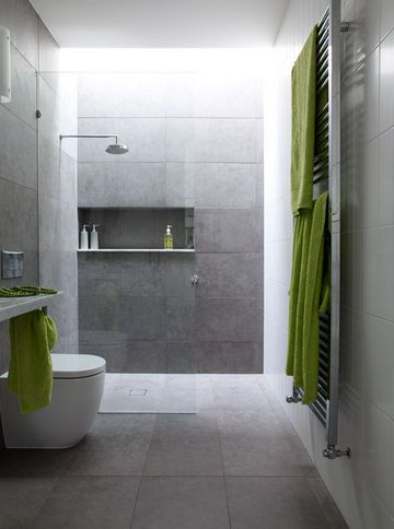 Large rectangular tiles wall and floor.