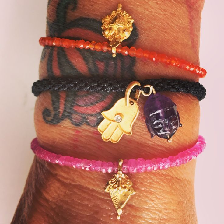 Bracelets precious stones 18 ct gold, carved stones, antique Indian charms and diamonds Lautropjewellery