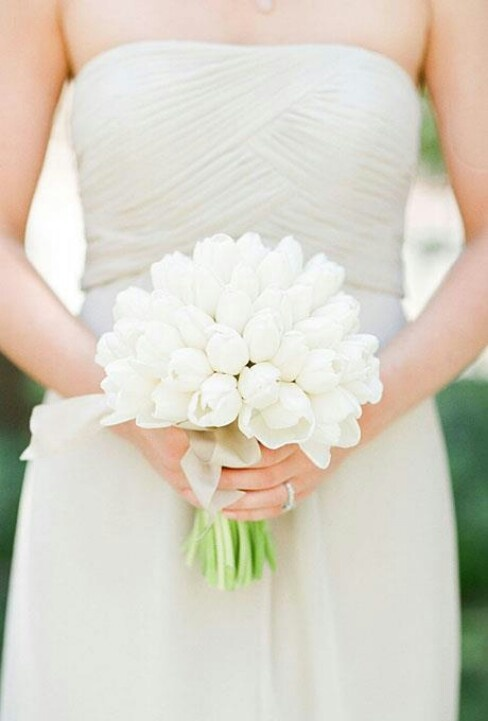 Tulip wedding bouquet...very pretty and maybe add a couple colored ones!