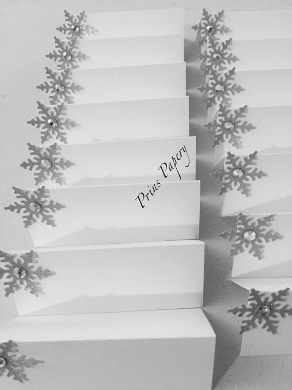 Wedding Silver Snowflake Holiday Christmas Place Cards Escort Cards 10 tent style 3 1/2 x 1 1/2 Snowflake place cards. Each Snowflake is cut from silver sparkle craft paper and has a gem in the center. These will add a festive feeling to any special event. These fun place cards can be used for any occasion. They are simple yet elegant. Tent style.  These are sold in sets of 10. Price listed is for one set. ***My place cards are made to order so please be sure to review my shipping p...