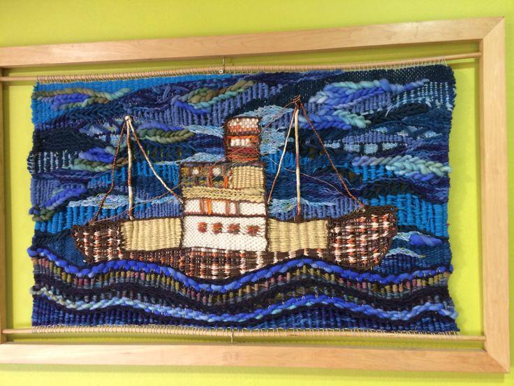Mural de un barco, inspirado en un cuadro de Hundertwasser, Hecho a mano con la tecnica de tapicería artística por Viviana Valiente