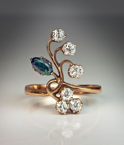 An Antique Russian Alexandrite and Diamond Art Nouveau Flower Ring, 1908-1917. The 14K gold ring is prong-set with a very rare Russian alexandrite and six old cut diamonds.