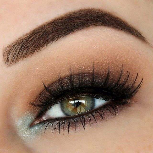 Soft gradient eyeshadow, full brow, long lashes, icy blue in inner corner.