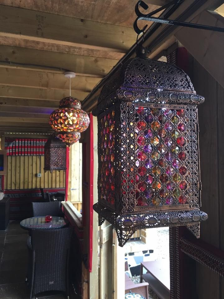 A #Moroccan style #latern and behind it a #Turkish style one. At the #Shisha #Garden #Cafe we care about our #interiordesign, we like to give #guests and #customers a #warm #welcome when they visit.
