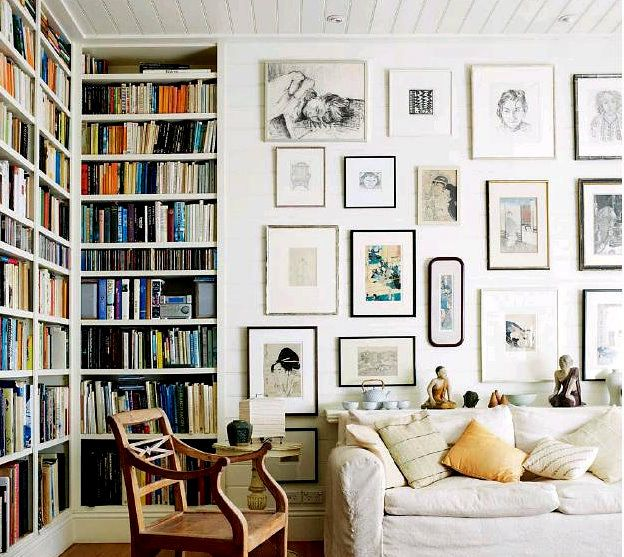 Bookcases and framed wall art ~ one day I will have this big a room for all these happy things!