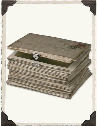 LOVE LETTERS BOX. Impersonating a stack of cherished correspondences, this clever chamber with hinged-lid will secure your treasures.