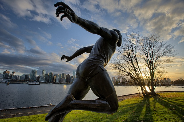 Bronze statue of Canadian track and field icon Harry Winston Jerome, as seen at dawn in Stanley Park, Vancouver, British Columbia, Canada -- by Timedrops Media, via Flickr