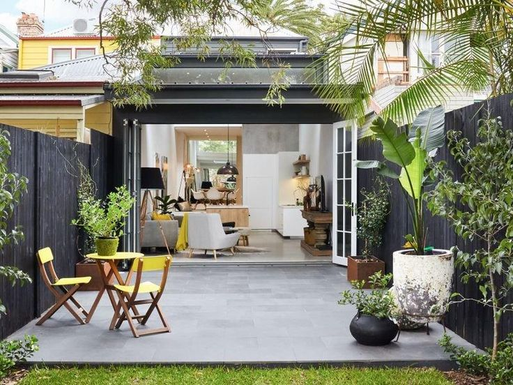 Not much over 4m wide but with its modern renovation and addition, this wooden terrace house in...