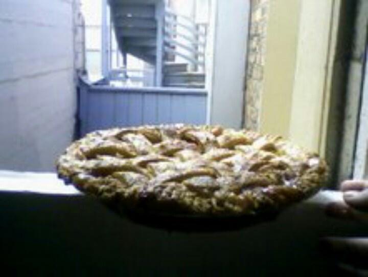 My peach vanilla cardamom pie.....*drool* cooling on the windowsill # ...