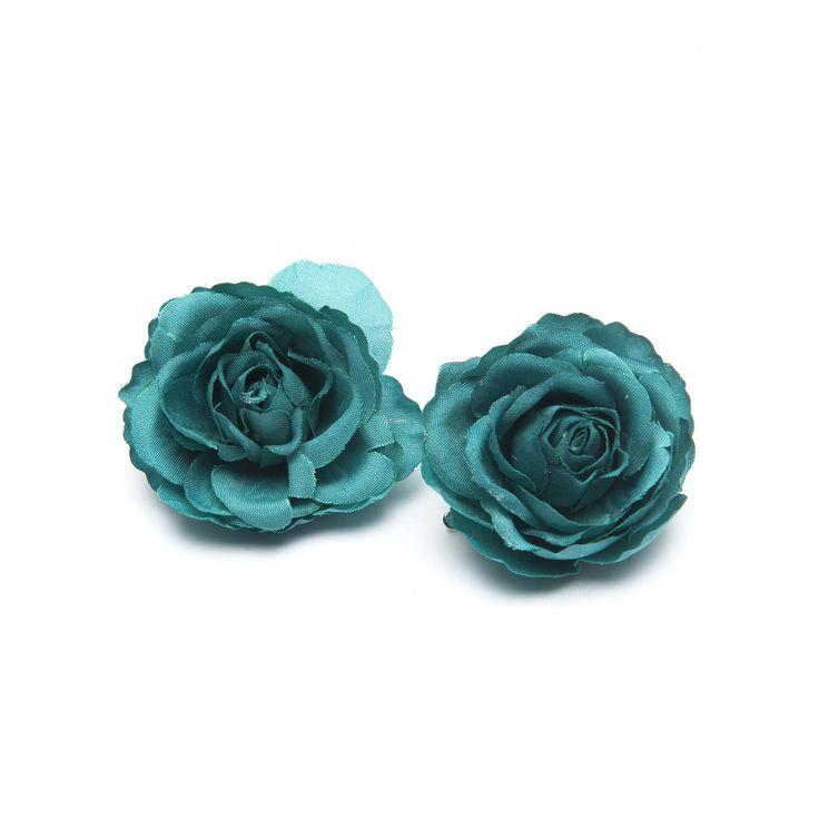 Ze lijken net echt, deze rozen voor in het haar van je dochtertje. De bloemen zijn vastgemaakt op 2 knijpspeldjes. Een prachtig haaraccessoire, geknipt voor een communie- of lentefeest, of voor een huwelijk. Stralen maar!