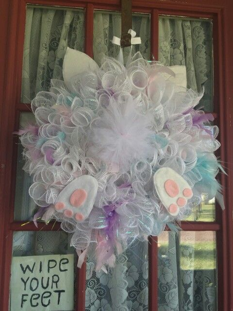 Easter Bunny Bottom Wreath Spiral Deco Mesh with hand made felt feet & ears and tulle pom pom tail. I incorporated different color feathers of blue, pink, and purple and glued them in between the deco mesh spirals, sporatically.