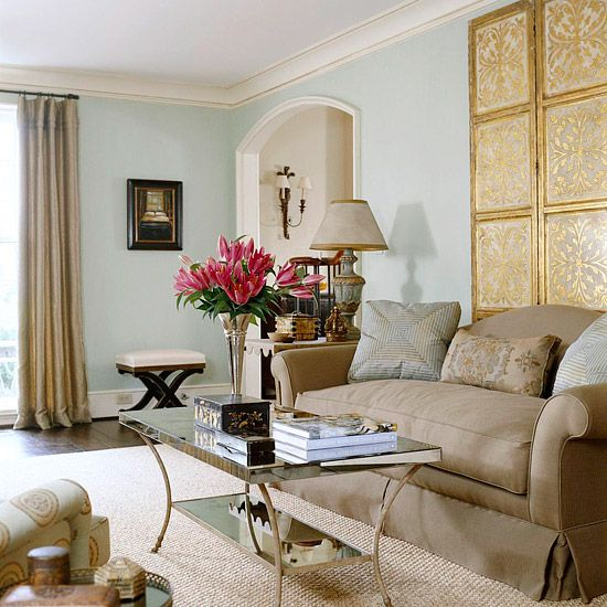 A little fancy for me, but love the colors and the scallop on the side table (hard to see...first noticed it in the coffee table reflection!). Also a perfect little puddle on the drapes.