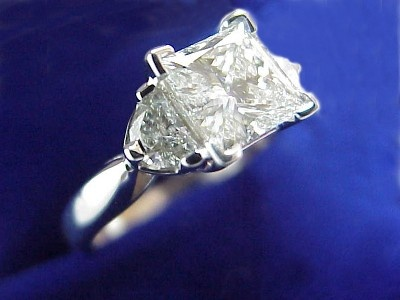 Princess Cut Diamond Ring,1.15 carat with 0.41 tcw half moon diamonds.