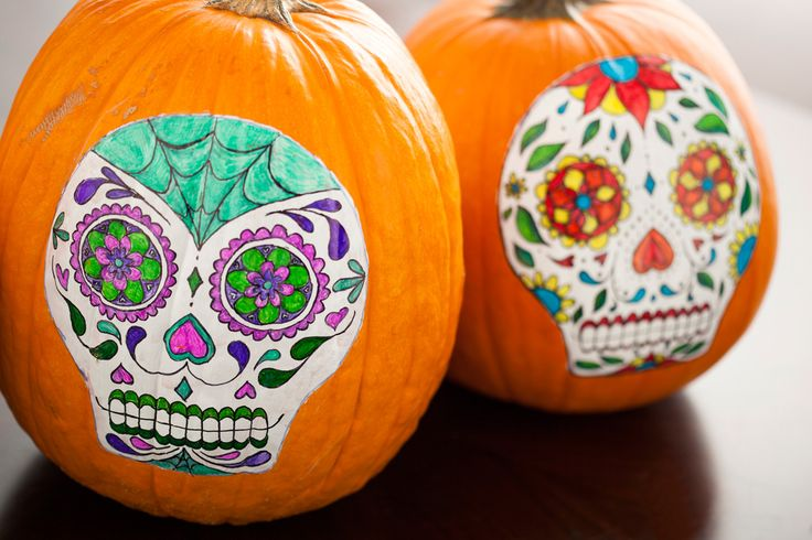 So colorful! These sugar skull pumpkins will brighten up any party.