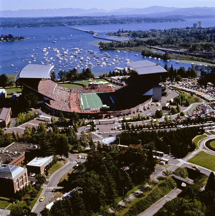 Husky Stadium,University of Washington, sits next to Union Bay in Lake Washington. The view from Husky Stadium is unmatched, overlooking Lake Washington and offering sweeping skylines of Downtown Seattle, Mt. Rainier and the Cascade Mountains to the east and the Olympic Mountain Range to the west.
