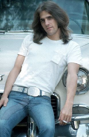 Glenn Frey...maybe not everybody's cup of tea but I love him...especially the long hair, beard, cheesy mustache, before I was born Glenn...good thing I wasn't around in 1974 I would have thrown it all away to be an Eagles groupie...yeah I said it :)