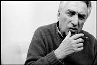 Roland Barthes smoking a cigar.