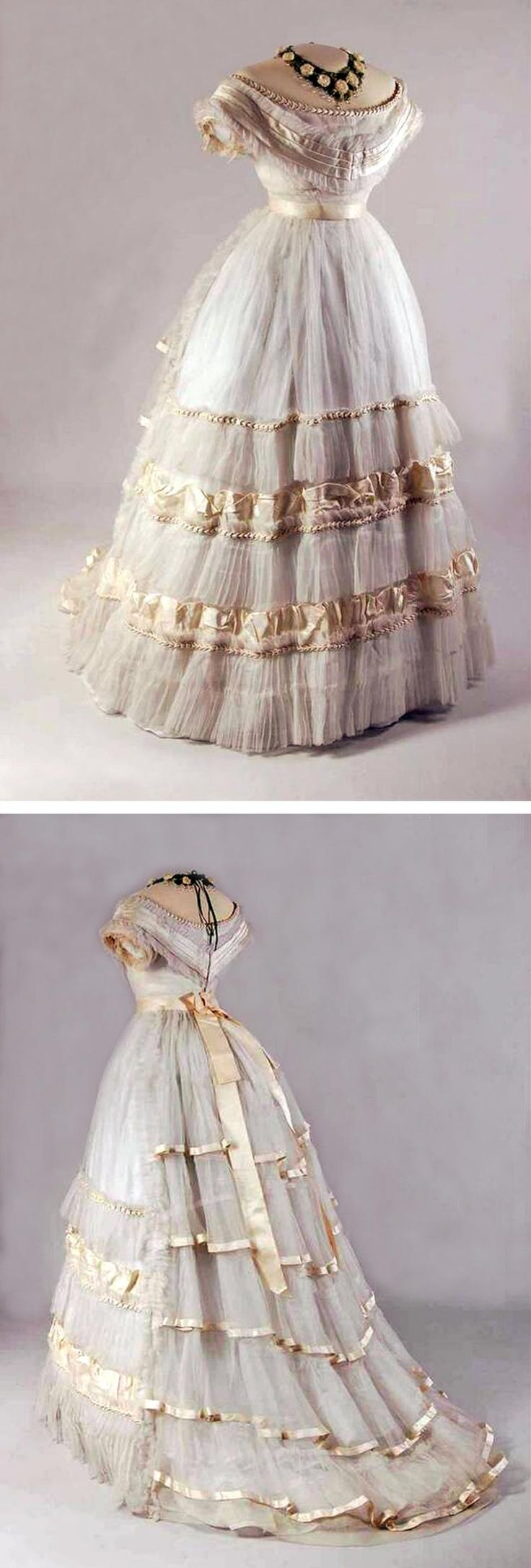 Ballgown, the Netherlands, ca. 1870-75. Silk trimmed with satin, 2 pieces. Bodice has low, oval neck, very short, tight sleeves, empire waist, and trailing queue; white cotton lining. Skirt has pleated linen waistband, closing behind with hooks & eyes. Vertical ruffles sewn onto lower half. Mode Museum, Antwerp, via Europeana Fashion