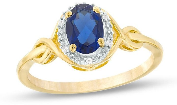 Zales Oval Lab-Created Blue Sapphire and Diamond Accent Twist Ring in 10K Gold tXytdXCNN