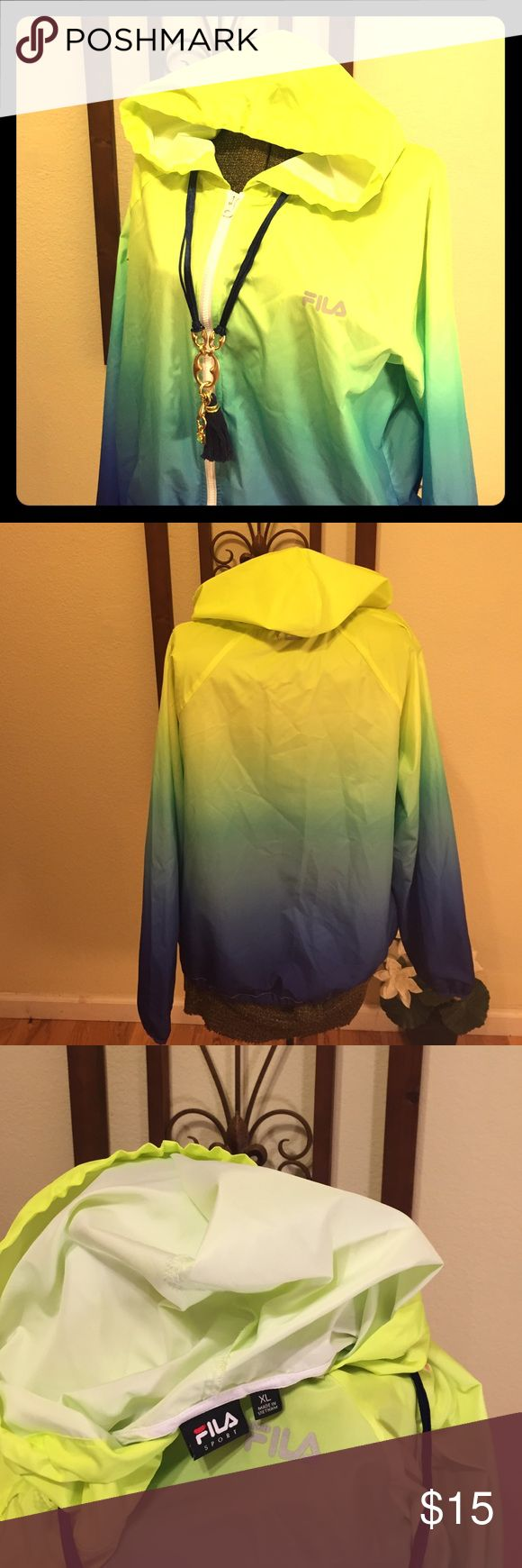 Fila SPORT wind-jacket Cool colors that runs from vibrant yellows to blue hues. SIZE XL, draw string bottom along with full zipper. Great jacket for any occasion. FILA Jackets & Coats