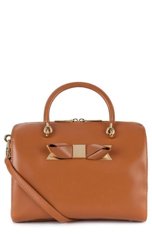 This bag is the perfect color and I love the classic lines with the subtle feminine detail of the bow.