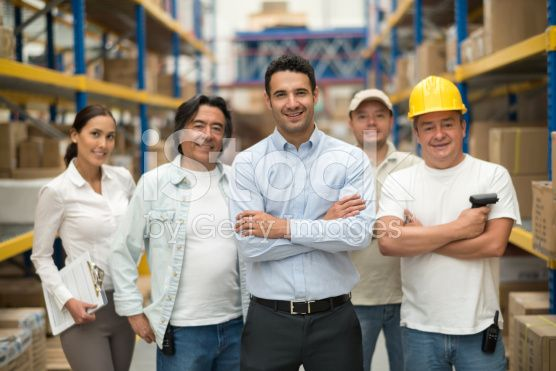 Group of workers at a warehouse royalty-free stock photo