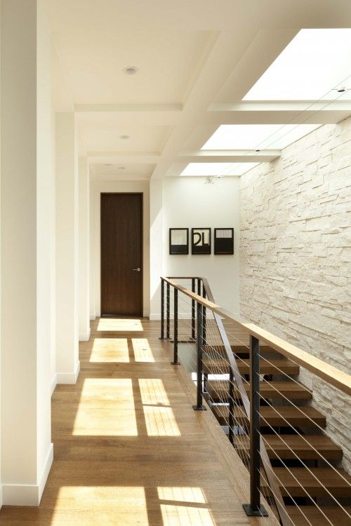 love this look with the wide plank open stairs and the wire railing