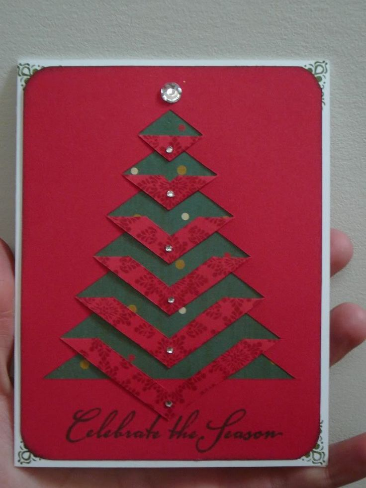 handmade Christmas card ... clean and simple ... cut and folded down branches on Christmas tree ... red top panel reveals green background below ... like that the back of the red paper is patterned and shows off the folding ... like this card!!: