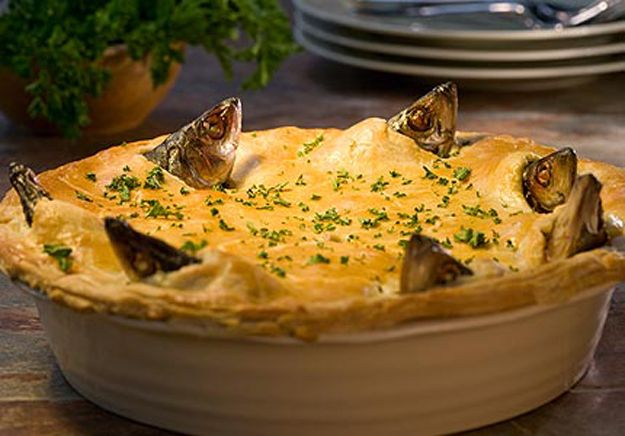 Stargazy Pie   18 Weird And Wonderful British Foods You Need ToTry - I'd like to try a few of these when I'm in the UK.