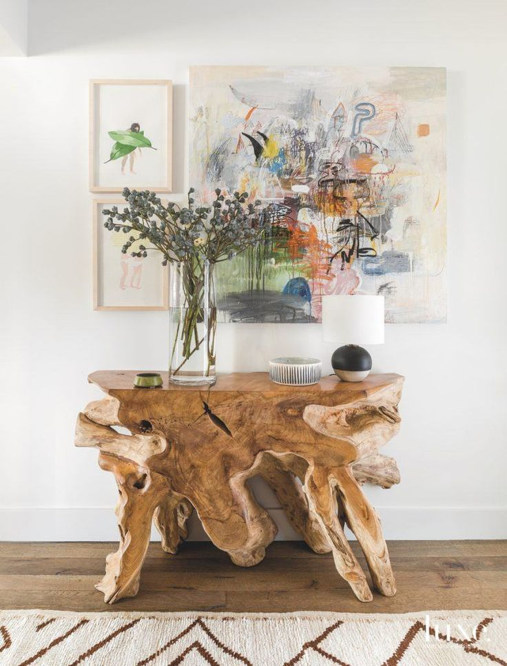 A petrified wood table coupled with artwork