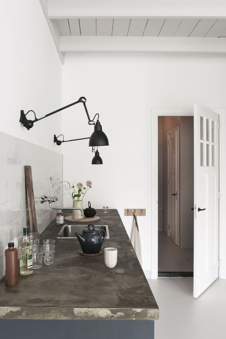 Black wall mounted task lighting in the kitchen |black Lampe Gras wall lights | kitchen lighting | Kitchen of the Week: The Curtained Kitchen, Dutch Modern Edition - Remodelista