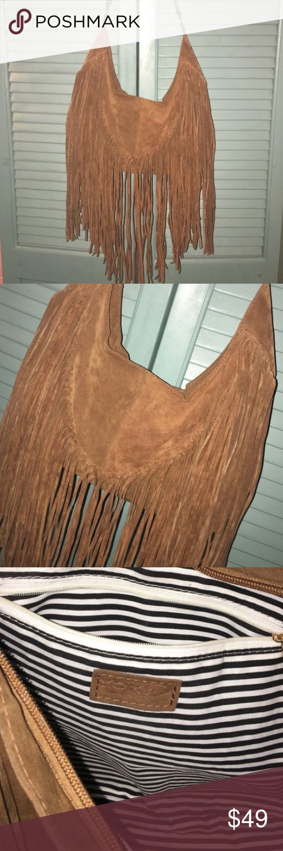 Leather fringe boho hobo bag Brown leather fringe bag with long cross body strap that is adjustable. In excellent condition, very boho and great for festivals, holds a lot! Bags Crossbody Bags