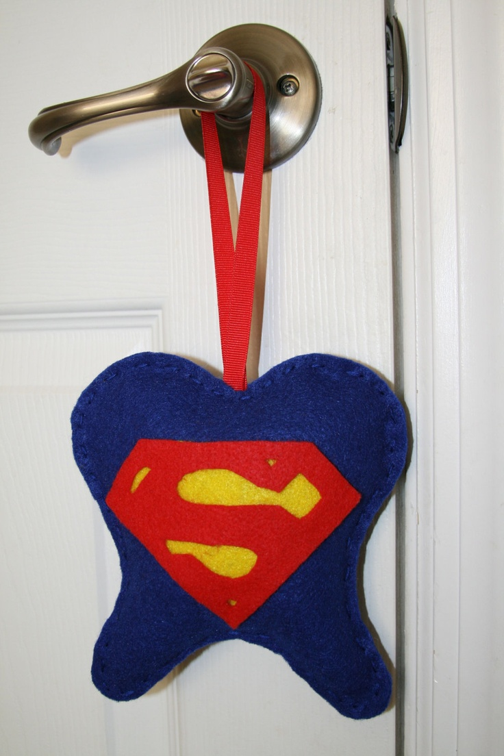 Love the idea of a doorknob-hanger instead of an under-the-pillow pouch!Personalized Superman Felt Tooth Fairy Pillow by TheClassyCrafter