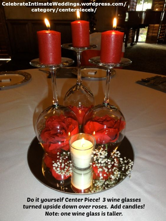 Do it yourself Center Piece! 3 wine glasses turned upside down over roses. Add candles! Note: one wine glass is taller.