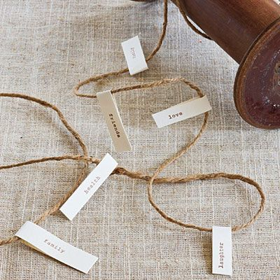 String Together a List of Blessings   Print out individual words on tabs, and fold them around twine. Weave the twine along the center of the table