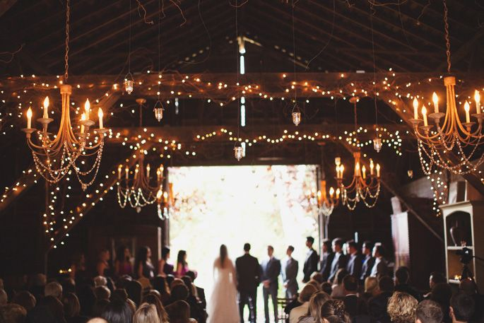 I just love these tiny lights and grapevines around the beams.
