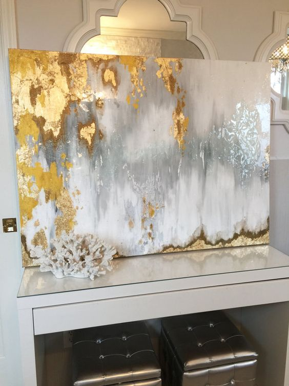 Gold leaf abstract art with gray and white ombre in Ikat inspired pattern in white and silver bathroom with chandelier: