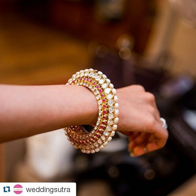 Stunning wedding jewellery from #Gehna, a must have for to-be brides!  #Repost  from @weddingsutra ・・・ Bride-to-be Mitali shares her experience about her Day with WeddingSutra Favourites. She tries on this stunning bangle by @gehnajewellers1 studded with uncut diamonds, rubies and pearls set in 18kt gold. More on www.weddingsutra.com/blog  Photo Courtesy- @whatknotin (Mumbai)  #ADayWithWeddingSutra #WeddingSutraFavorites #WeddingSutraSpecialists #bridetobe #GehnaJewellers #kadaa #gehna…